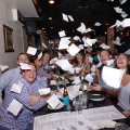Opa! Group tossing napkins